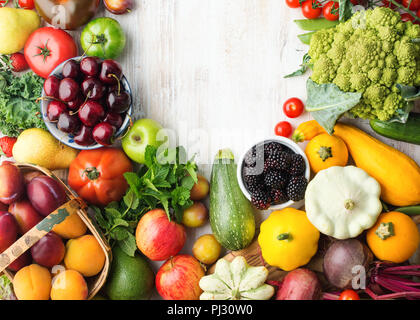Healthy eating, summer fruits vegetables berries, cherries peaches broccoli squash tomatoes plums beans beetroot, copy space, top view, selective focus - Stock Photo