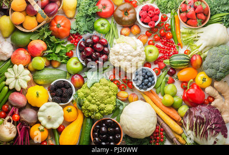 Healthy summer fruits vegetables berries background, cherries peaches strawberries cabbage broccoli cauliflower squash tomatoes carrots spring onions beans beetroot, pepper, top view, selective focus - Stock Photo