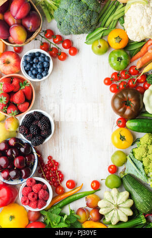 Healthy summer fruits vegetables berries arranged in a frame, cherries peaches strawberries cabbage broccoli cauliflower squash tomatoes carrots beetroot, copy space, top view, selective focus - Stock Photo