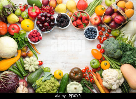Fresh summer fruits vegetables berries background, cherries peaches strawberries cabbage broccoli cauliflower squash tomatoes carrots beans beetroot, pepper, top view, selective focus - Stock Photo