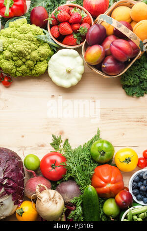 Fresh fruits vegetables berries assortment on wooden table, copy space, top view, selective focus - Stock Photo