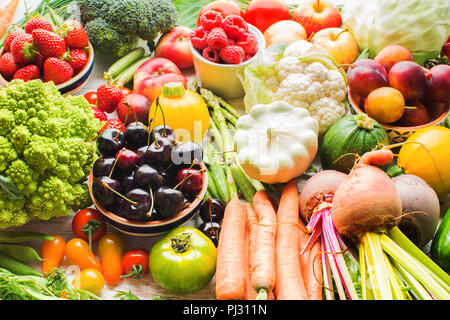 Lots of summer fruits vegetables berries, apples cherries peaches strawberries cabbage broccoli cauliflower squash tomatoes carrots spring onions beans beetroot, selective focus - Stock Photo