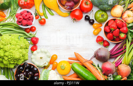 Colourful farm produce, fruits vegetables berries, apples cherries peaches strawberries cabbage broccoli cauliflower squash tomatoes carrots spring onions beans beetroot, copy space, top view - Stock Photo