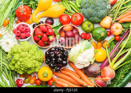 Summer fruits vegetables berries background, apples cherries peaches strawberries cabbage broccoli cauliflower squash tomatoes carrots spring onions beetroot, top view, selective focus - Stock Photo
