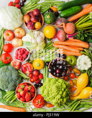Summer fruits vegetables berries background, apples cherries peaches strawberries cabbage broccoli cauliflower squash tomatoes carrots spring onions beetroot, top view, vertical, selective focus - Stock Photo