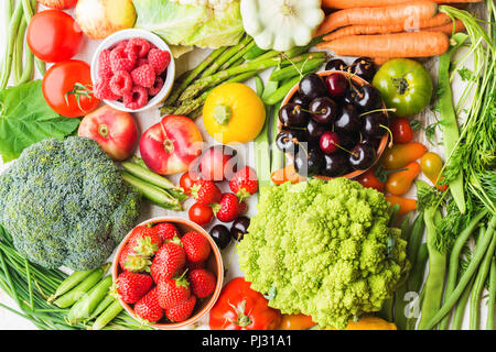 Summer fruits vegetables berries background, apples cherries peaches strawberries cabbage broccoli cauliflower squash tomatoes carrots spring beetroot, copy space, top view, selective focus - Stock Photo