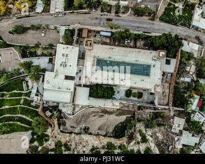 Vista aerea del Museo Regional de Sonora, INAH, fue la primera cárcel de Hermosillo, antigua penitenciaría.  Se fundó en el año de 1815 en el centro historico y faldas del cerro de la campana icono de la ciudad. En los últimos años del siglo XIX el gobierno del estado de Sonora decidió la construcción de un moderno edificio con fines penitenciarios, para ello se contrató al ingeniero nacido en Francia Arthur Francis Wrotnowski... City Aerial Shot, Arquitecture, City Day, Edificios Hermosillo, Mexico Sonora, aerial, aerial landscape, aerial photography, aerial view, view of city, ,day, daylight - Stock Photo