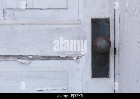 old paint peeling from wood door - Stock Photo