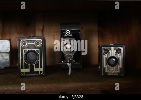 vintage cameras on shelf Stock Photo