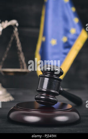 Law and Justice, Legality concept, Judge Gavel, Scales of Justice and European Union flag on a black wooden background. - Stock Photo