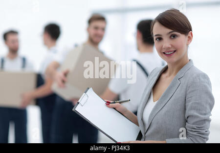Businessman with documents, creating a stack of cardboard boxes. - Stock Photo