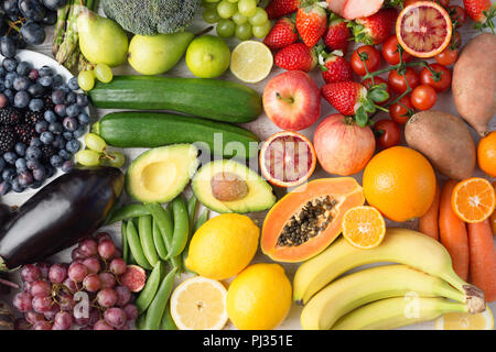 Healthy eating, assortment of fruits and vegetables in rainbow colours background, top view, selective focus - Stock Photo