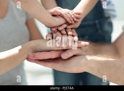 close up.family hands folded together - Stock Photo