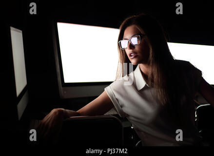 young business woman sitting in computer room. - Stock Photo