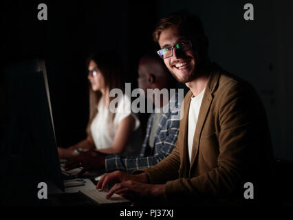 businessman working on the computer in the office at night. - Stock Photo