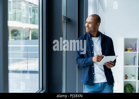 happy african american entrepreneur using tablet computer. - Stock Photo