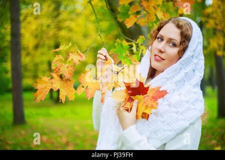 beautiful young plussize model with long curly hair in the autumn park - Stock Photo