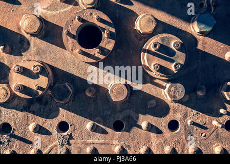 Detail of an old rusty wagon abandoned in the train cemetery of Uyuni, Bolivia - Stock Photo