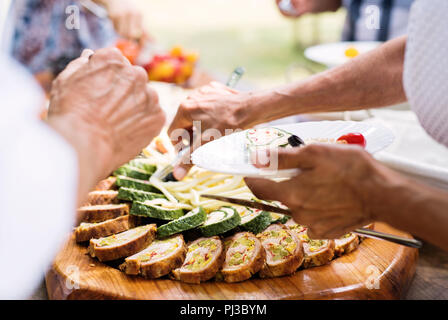 Family celebration or a garden party outside in the backyard. - Stock Photo