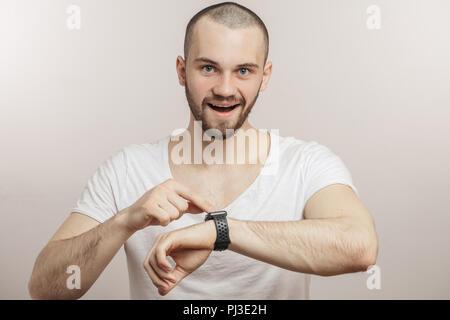 joyful man working on the wristwatch - Stock Photo