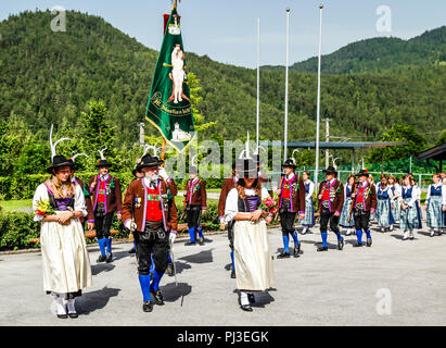 Tyrolean Militia men and maidens march out of the village square on Patronage day in Reith bei Seefeld, Austria - Stock Photo