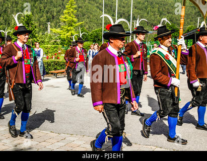 Men of the Tyrolean Militia march out of the  village square on Patronage day in Reith bei Seefeld, Austria - Stock Photo