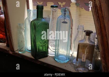 old bottles on window sill Stock Photo