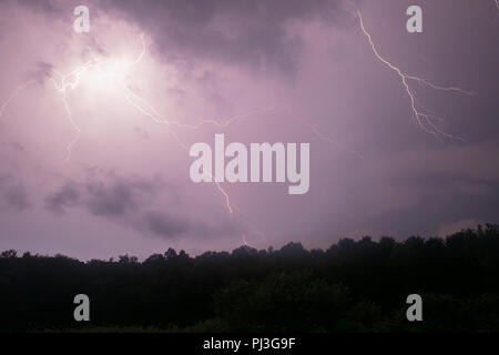 lightning above a mountain - Stock Photo