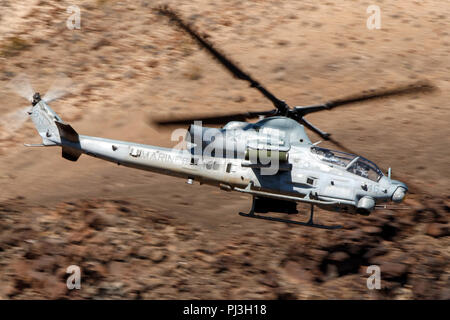 United States Marines Corps Bell AH-1Z Viper (SN 168529) flies low level on the Jedi Transition through Star Wars Canyon / Rainbow Canyon, Death Valley National Park, Panamint Springs, California, United States of America - Stock Photo