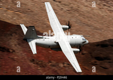 Alenia C-27J Spartan from the Italian Air Force (side 46-88, registration MM62223) flies low level on the Jedi Transition through Star Wars Canyon / Rainbow Canyon, Death Valley National Park, Panamint Springs, California, United States of America - Stock Photo