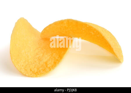 two potato chips on white background close-up - Stock Photo