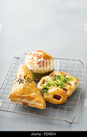 Savory red bean, pork and green onion pastries from Chinese bakery - Stock Photo