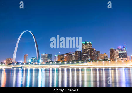 st. louis skyscraper at night with reflection in river,st. louis,missouri,usa. - Stock Photo