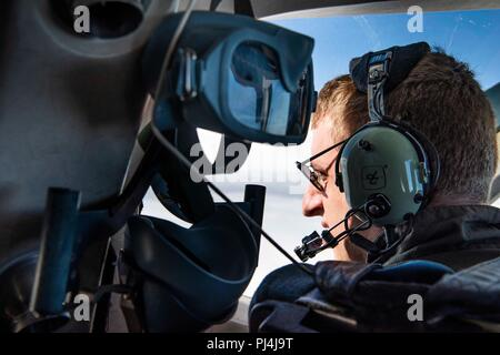 U.S. Air Force Capt. Joe Eastman, 3rd Flying Training Squadron, checks his wing for icing during continuation training, Vance Air Force Base, Aug. 24, 2018. Continuation training allows instructor pilots to maintain their proficiency and qualifications. (U.S. Air Force photo by Tech. Sgt. Erik Cardenas) - Stock Photo