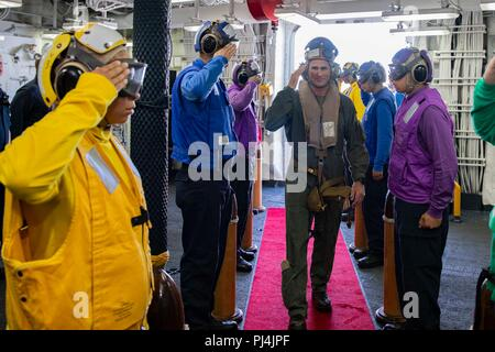 180822-N-MC499-0054 ATLANTIC OCEAN (Aug. 27, 2018) Vice Adm. Andrew 'Woody' Lewis, commander of the recently reestablished U.S. 2nd Fleet, is rendered honors as he arrives aboard the Wasp-class amphibious assault ship USS Kearsarge (LHD 3) as the first official stop on his tour of forces under his command.  Kearsarge is underway for the Carrier Strike Group FOUR (CSG 4) Amphibious Ready Group, Marine Expeditionary Unit exercise (ARGMEUEX).  Kearsarge Amphibioius Ready Group and 22nd Marine Expeditionary Unit are enhancing joint integration, lethality and collective capabilities of the Navy-Mar - Stock Photo