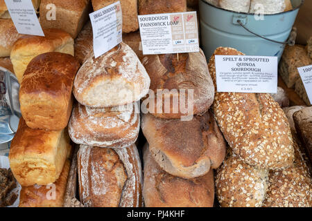 Sourdough bread for sale on the The Artisan Baker stall at stroud farmers market. Stroud, Gloucestershire, England - Stock Photo