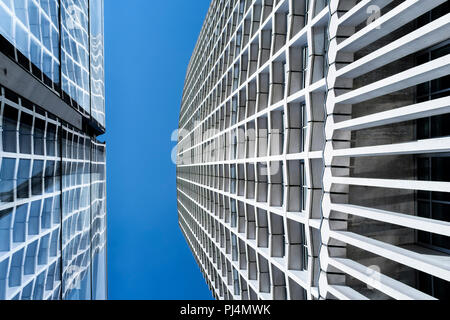 Abstract architecture: Centre Point building with reflection in glass facade of Tottenham Court Road underground station, London, UK - Stock Photo