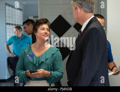 Dr. Angela Hemingway, the executive director of the Idaho STEM Action Center, speaks with Lt. Gov. Brad Little, lieutenant governor for the state of Idaho, before the grand opening ceremony of Starbase Idaho at Gowen Field, Boise, Idaho on Aug. 31, 2018. Starbase is a Department of Defense program designed to motivate students, primarily socio-economically disadvantaged fifth graders, to explore more education in science, technology, and math areas of study. (U.S. Air National Guard photo by Master Sgt. Joshua C. Allmaras) - Stock Photo