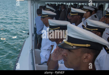180831-N-AV243-0009 PEARL HARBOR (August 31, 2018) U.S. Navy Midshipmen honor the lives lost on December 7th, 1941 during a Pearl Harbor memorial boat tour.  The U.S. Navy Midshipmen visited the Pearl Harbor visitor center the day prior to their game against University of Hawaii's Rainbow Warriors on September 1, 2018. (U.S. Navy photo by Mass Communication Specialist 2nd Class Somers T. Steelman.) - Stock Photo