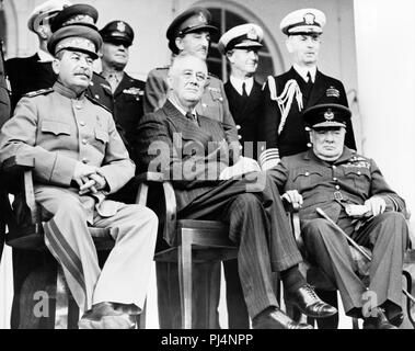 Tehran Conference.  Joseph Stalin (left), Franklin D. Roosevelt (centre) and Winston Churchill.  The conference was held from November 28 to December 1, 1943. The most important result from the agenda was an agreement that the Allies would open a second front against Nazi Germany. - Stock Photo