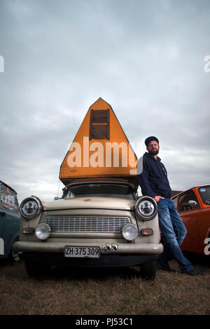 Andreas Leibezeit with his 1986 P601 Trabant and original DDR Tent attachment. - Stock Photo
