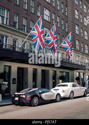 Bugatti Veyron and Rolls Royce Phamtom parked outside Mayfair Hotel London UK - Stock Photo