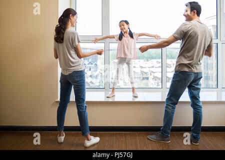 Happy young family working on home renovation - Stock Photo