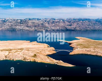 Pag bridge with mountain range Velebit in the background and Adriatic sea, Croatia, Zadar county - Stock Photo