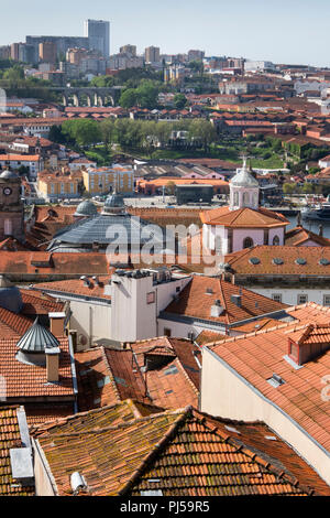 Portugal, Porto, Ribeira, rooftops, looking south towards Douro River to Port Wine Cellars district - Stock Photo