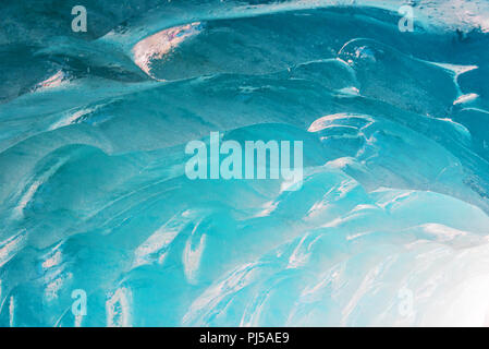 Detail of an ice wall inside the ice cave of the Mer de Glace glacier,  in Chamonix Mont Blanc Massif, The Alps, France - Stock Photo