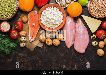Background with healthy food. Red fish, chicken fillet, vegetables, fruits, cereals, dairy products, quail eggs. Top view, copy space. - Stock Photo