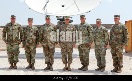 U.S. Army Gen. Joseph Votel, U.S. Central Command commander, center, poses for a photo with 1st Space Brigade Soldiers during his visit to Camp As Sayliyah, Qatar, August 30, 2018. The visit provides Gen. Votel with a deeper understanding of the unique capabilities ASG-Qatar and U.S. Army Central Soldiers provide to USCENTCOM's mission. (Photo by U.S. Army Sgt. James Lefty Larimer) - Stock Photo