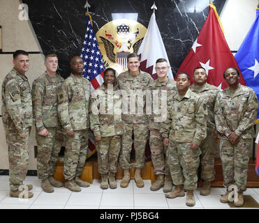 U.S. Army Gen. Joseph Votel, U.S. Central Command commander, center, poses for a photo with Area Support Group – Qatar Soldiers during his visit to Camp As Sayliyah, Qatar, August 30, 2018. The visit provides Gen. Votel with a deeper understanding of the unique capabilities ASG-Qatar and U.S. Army Central Soldiers provide to USCENTCOM's mission.  (Photo by Jane Armstrong/Caption by U.S. Army Sgt. James Lefty Larimer) - Stock Photo