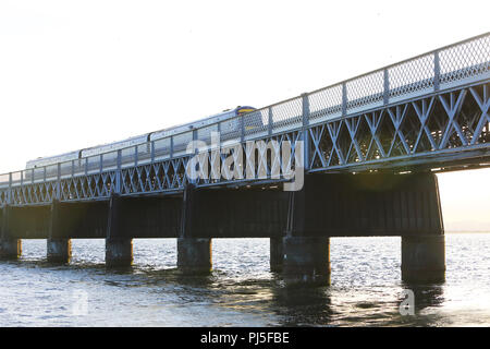 A train crossing the Tay Rail Bridge, over the Estuary between the City of Dundee and Fife, in Scotland, UK - Stock Photo